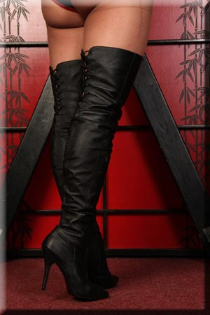 Mistresses thigh high leather boots