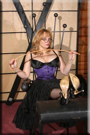 Mistress in corset with cane